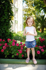 Adorable girl portrait outdoors at summer