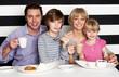 Family enjoying breakfast at a restaurant