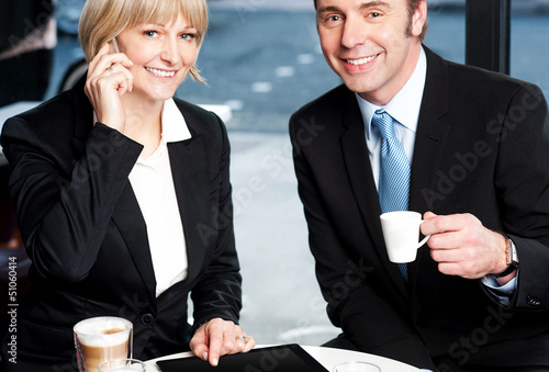 Two business professionals at coffee shop