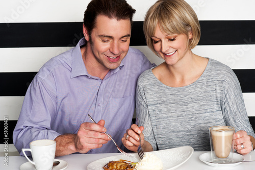 Beautiful couple having morning meal together