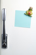 Blank note on fifties fridge-door, close-up of frog with crown h