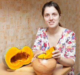 woman cooking pumpkin in pot