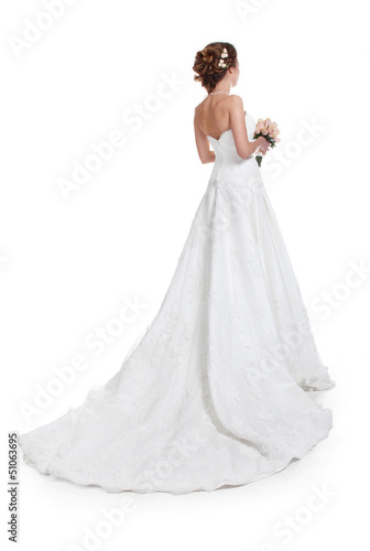 Beautiful bride in luxurious wedding dress with train isolated o