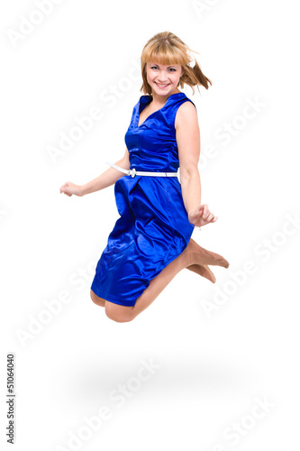 Cute elegant woman in blue dress jumping