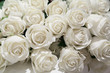 Bunch of artificial white roses with selective focus
