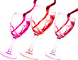 Three glasses of red wine abstract splash isolated on white bac