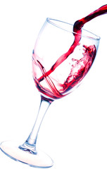 Splash of red wine in glass isolated on white background