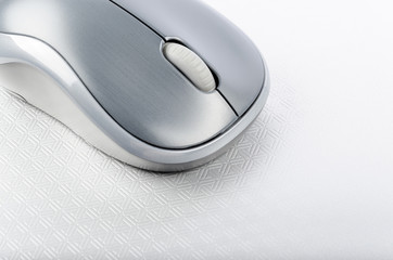Wireless computer mouse on a metallic background