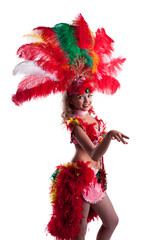 Playful young dancer in colorful festival costume