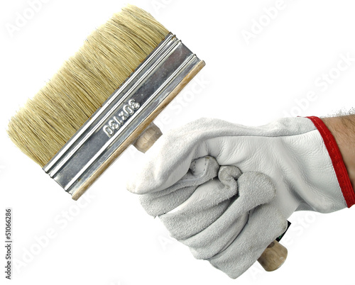 Gloved hand with brush