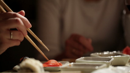 Eating sushi. Close up.