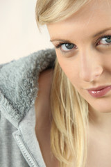 Closeup of a pretty blonde in a grey hoody