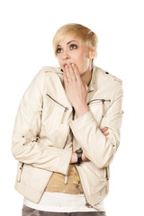 ashamed pretty blonde with short hair posing on white