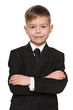 Smiling young boy in black suit