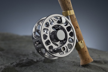 reel fishing rod on a blue background