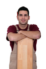 Man leaning on parquet slat