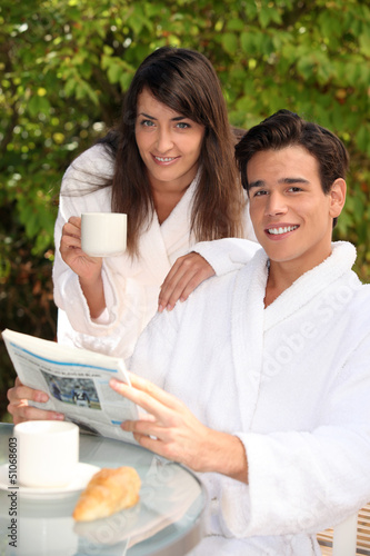 young couple on vacation having breakfast