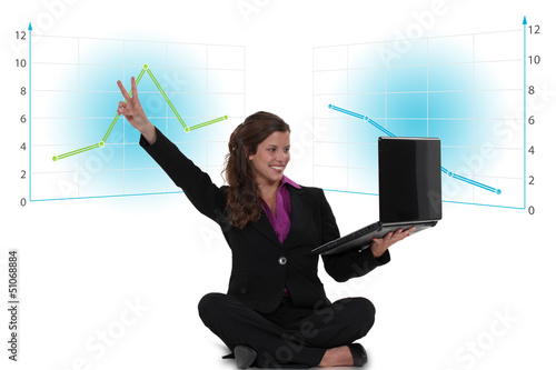 Victorious businesswoman with a laptop