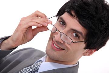 Businessman peering over his glasses