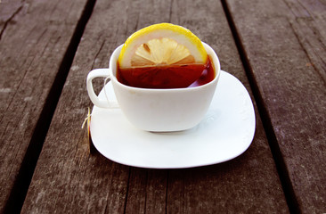 cup of tea on wooden bachground