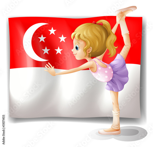 A girl dancing in front of the flag of Singapore