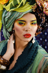 sensual easten girl with shawls on her head