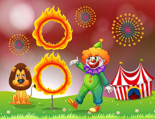 A carnival with a clown and a lion near the ring of fire