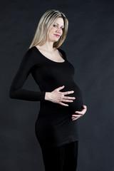 portrait of pregnant woman wearing black clothes