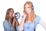 girl listening to music and friend shouting in loudspeaker