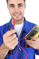 Electrician displaying voltmeter
