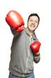 Man wearing boxing gloves smiling