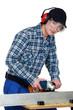 Young man using hacksaw