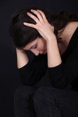 woman having headache isolated on black