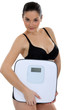 Woman in underwear carrying scales