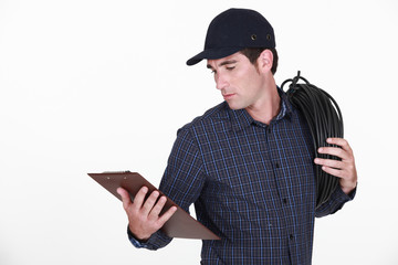 Electrician holding clipboard