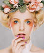 Genuine Natural Blonde Bride with Pink Flowers. Artistry