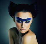 Classy Woman with Blue Painted Mask and Modern Hairstyle