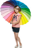 Little girl standing under colorful umbrella in full length