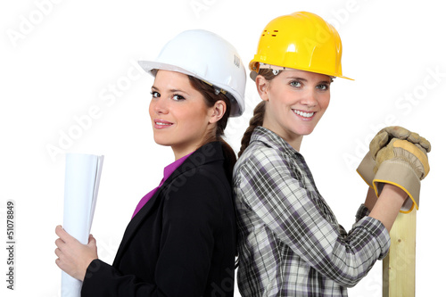 craftswoman and businesswoman standing back to back