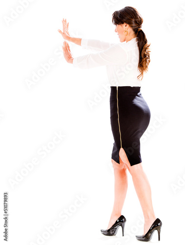 Business woman pushing an object