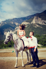 Bride and groom on the background of mountains