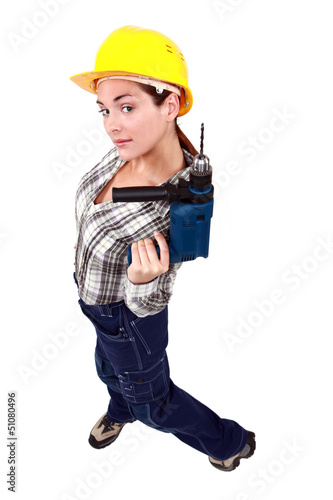 A female manual worker with a drill.