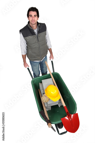 bricklayer with wheelbarrow