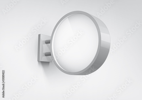 Blank, white round shop sign hanging on a wall