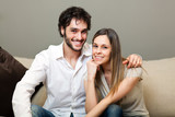 Portrait of a lovely young couple sitting on the couch