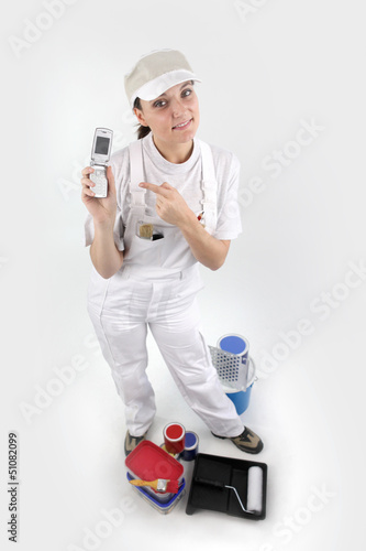 Painter pointing to her mobile phone
