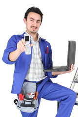 plumber with computer showing phone