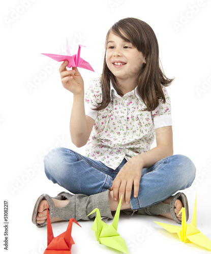 Cute girl with origami birds
