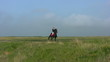 Girl riding a horse in the steppe