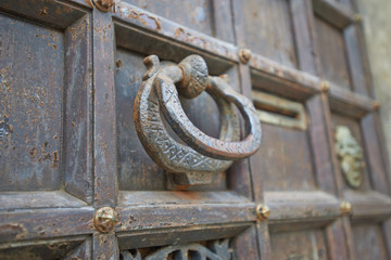 Door in Venice with old kind of bell
